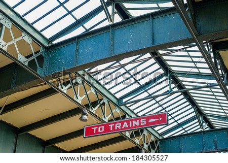 Signs leading to train platforms inside an old abandoned Train depot or train station - stock photo