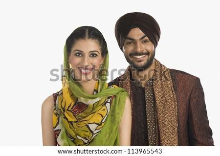 Sikh couple smiling - stock photo