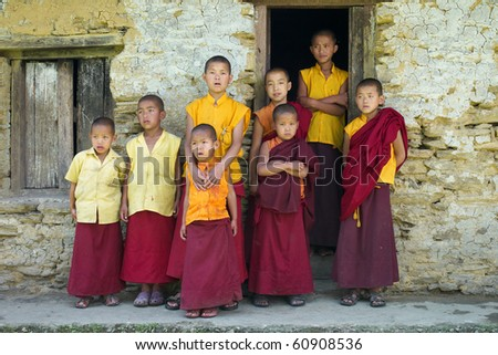 SIKKIM, INDIA - MAY 05: Little monks in front of a house at Sangachoeling Gompa on May 05, 2010 in Sikkim, India. Sangachoeling is a popular monastery in Sikkim. - stock photo
