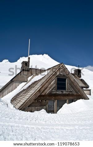 Silcox Hut on Mount Hood, Oregon, covered in deep snow - stock photo