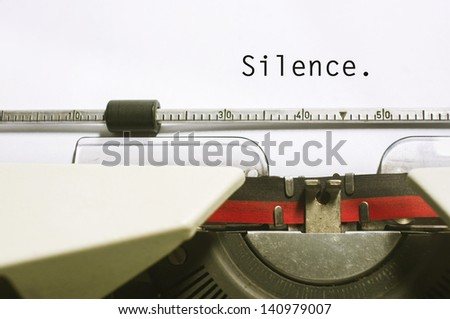 silence message is typed on typewriter, for conceptual background. - stock photo