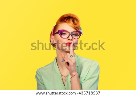 Silence. Woman  asking for silence or secrecy with finger on lips hush hand gesture yellow background wall. Pretty girl placing fingers on lips, shhh sign symbol. Negative emotion facial expression - stock photo