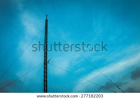 Silhouette antenna on the building with sky and cloud background - stock photo