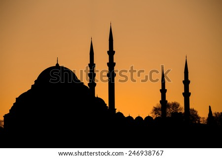 Silhouette at sunset. The Suleymaniye mosque in Istanbul. - stock photo