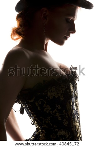 silhouette backlight picture of sexy woman in corset - stock photo