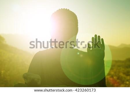 Silhouette Buddha Sky evening blurred bokeh background. Inspiration creativity mystery peaceful gentle dedicated advancement Buddha Purnima Vesak Full Moon Poya Day Visakha Bucha Visak Bochea - stock photo