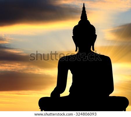 Silhouette Buddha statue with sunset background, Bangkok Thailand - stock photo