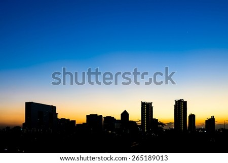 Silhouette building in Bangkok at sunset. - stock photo