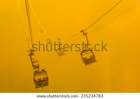 Silhouette Cable Cars in fog - stock photo