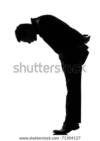 silhouette caucasian business man   man  tip toe looking down expressing behavior full length on studio isolated white background - stock photo