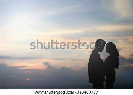 silhouette caucasian lovers couple on sunrise beach nature background at the beach:black shadow people hug/kiss:passion in love concept:horizontal landscape wallpaper decorations,design,valentines day - stock photo