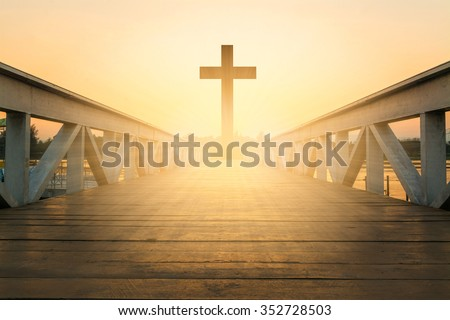 silhouette christian cross at railhead wooden bridge and orange sky with lighting,religion concept - stock photo