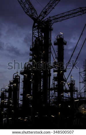 silhouette column tower and crane in twilight time ,day to night - stock photo
