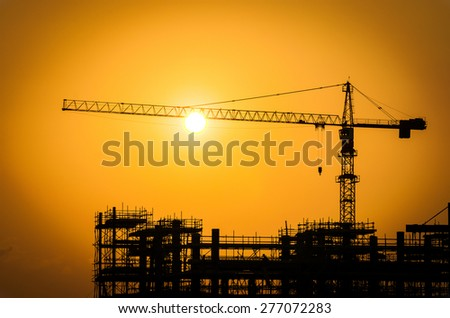 Silhouette construction oil refinery - stock photo