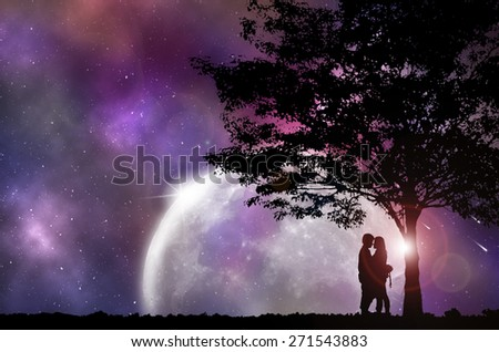 Silhouette Couple and tree, with beautiful night sky, Concept looking out to the outside world. - stock photo