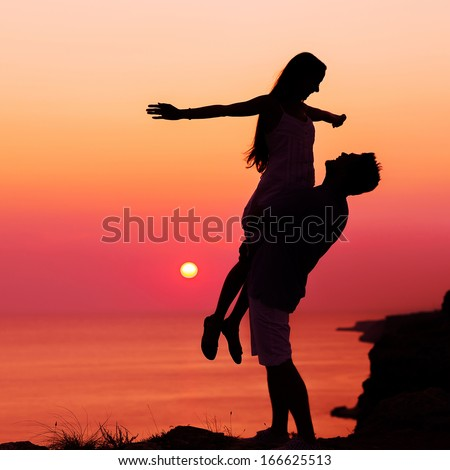 silhouette couple in love - stock photo
