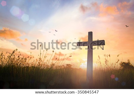 Silhouette cross on blur beautiful autumn sunset with amazing light background. Merry Christmas Card Thankful Adoration Glorify Peace Evangelical Hallelujah Blessing Amen Hope Religion concept - stock photo