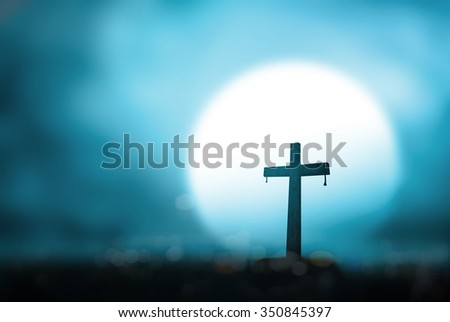 Silhouette cross on blur night light background. Merry Christmas Card Thankful Adoration Glorify Peace Hallelujah Blessing Amen Hope Religion Full Moon Redeemer Redemption Love God Pentecost concept - stock photo