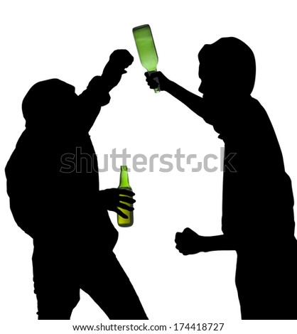 Silhouette drunk men having a fight while holding a bottle of beer - stock photo
