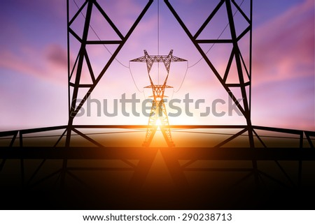 silhouette electricity post on sunset background - stock photo