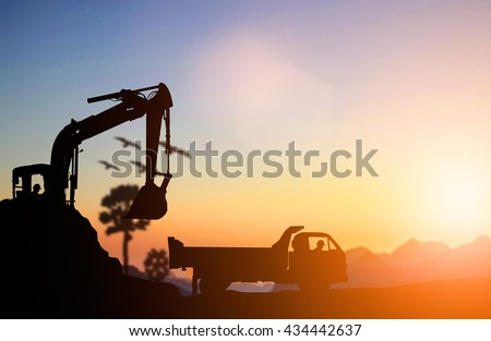 silhouette Excavator and truck working at construction site. Construction used heavy machinery to move earth. concept construction and heavy industry, machine will be used in heavy industry business. - stock photo