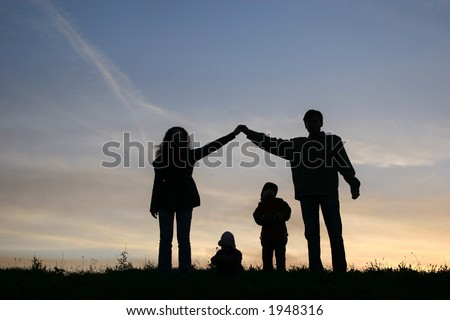 silhouette family house - stock photo