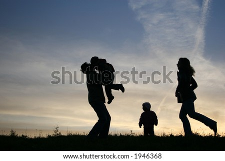 silhouette family of four - stock photo