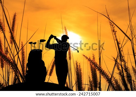 silhouette golfer  beautiful sky backlit sunset background. - stock photo