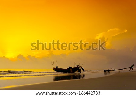 silhouette group of fisherman at work on great sunrise - stock photo