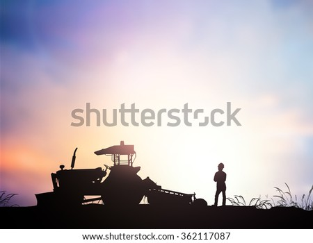Silhouette Harvesting machine on a farm planted with vegetables, organic, non-toxic treatments. Food concept, business concept, the lifestyle concept, the agricultural industry concept. - stock photo