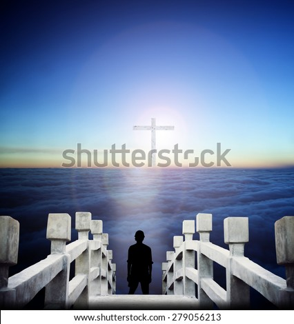 Silhouette Human standing over blurred the white cross in dark room and looking for freedom. - stock photo