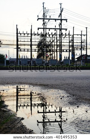 Silhouette image of electric station with colored sky in twilight time. - stock photo
