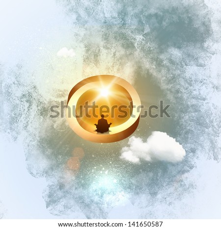 Silhouette image of man sitting in meditation pose - stock photo