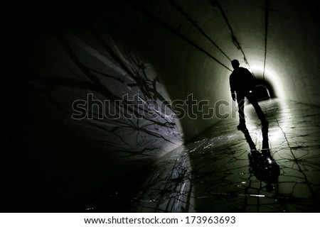 silhouette in a underground bunker from cold war - stock photo