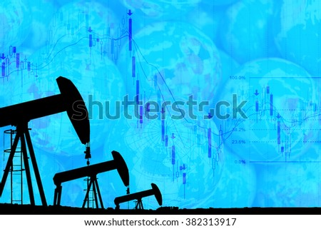 silhouette industrial oil pump jack and falling oil graph on the blue globe background - stock photo