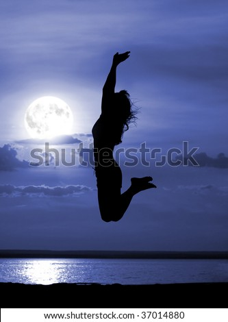 Silhouette jumping women on moon night - stock photo
