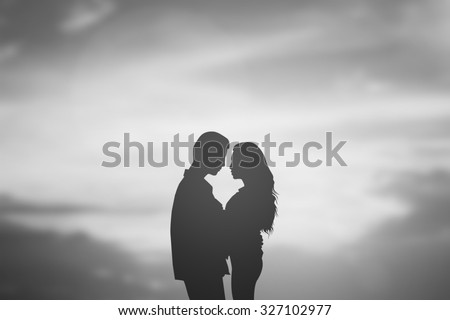 silhouette lover couple over natural backgrounds at the beach :black shadow loving people hug and try to kiss for show about their love each other : passion in love concept.valentines concept. - stock photo