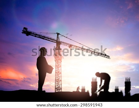 silhouette man engineer looking blurred construction worker on construction site - stock photo