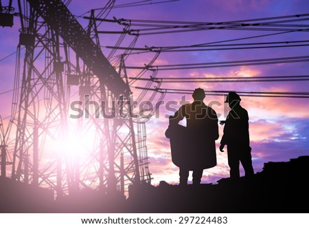 Silhouette man engineer looking construction worker under tower crane in a building site over Blurred construction worker on construction site - stock photo