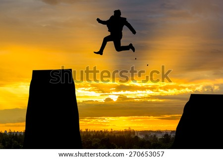silhouette Man Jumping in sun rise. - stock photo