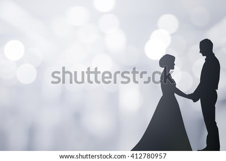 silhouette married lovers couple over blur bokeh light background:black shadow loving people holding/touching hand:love and valentines concept:matrimonial/amour/affection/wedding/anniversary - stock photo