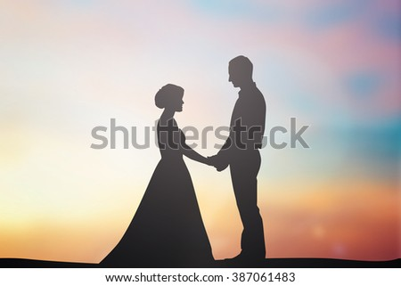 silhouette married lovers couple over natural sky background at the beach:black shadow loving people holding/touching hand:love and valentines concept:matrimonial/amour/affection/wedding/anniversary - stock photo