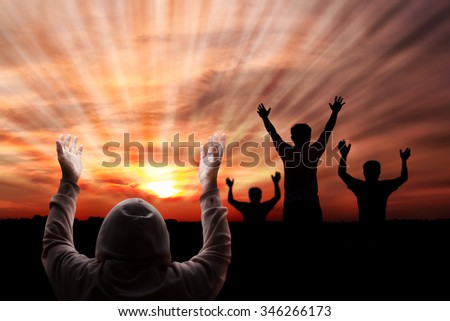 silhouette men bathing golden heaven light on sky Hope and Pray concept abstract blurred background from nature - stock photo