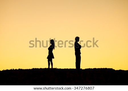 Silhouette of a angry woman and man on each other / Relationship difficulties / Couple break up - stock photo