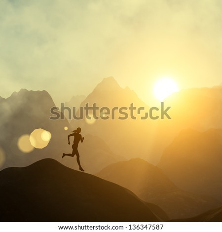 Silhouette of a beautiful woman running down the hill against yellow sky with clouds at sunset - stock photo