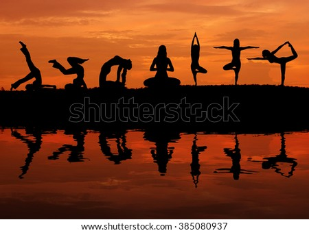 Silhouette of a beautiful Yoga woman at sunset with water reflection - stock photo