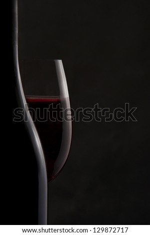 Silhouette of a Bottle and Red Wine Glass - stock photo