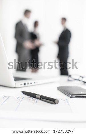 silhouette of a business people  with symbolic business objects in the foreground - stock photo