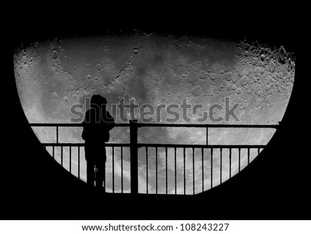 Silhouette of a child staring at the Moon. Science education. - stock photo
