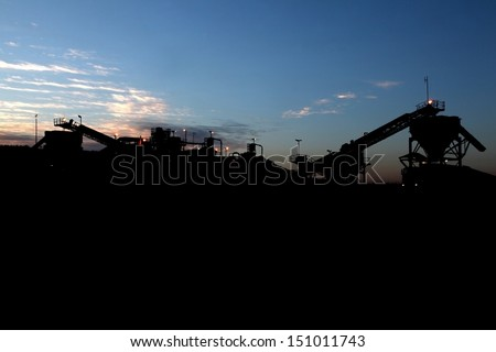 Silhouette of a coal mine in operation in South Africa near Carolina. Coal mine in the early hours of the morning.  - stock photo